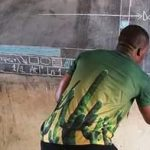 Ghanaian teacher uses blackboard to explain software